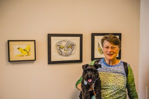 Jane Knodell enjoys the artwork with her furry companion.